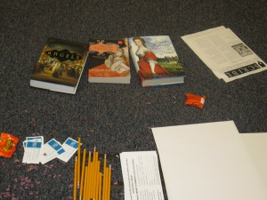 Karleen Koen's novels plus other incentives on classroom floor. By Kathy Waller.