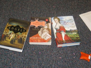 Three of Karleen Koen's novels on classroom floor at WLT retreat, Alpine, TX, 2014